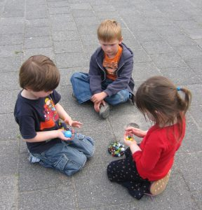 Children playing marbles