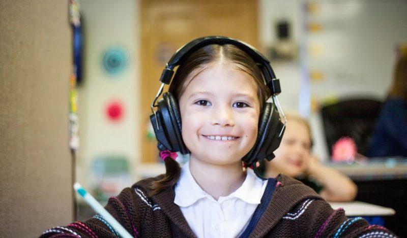 Girl wearing headphones at school