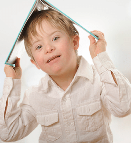 Child with book on his head