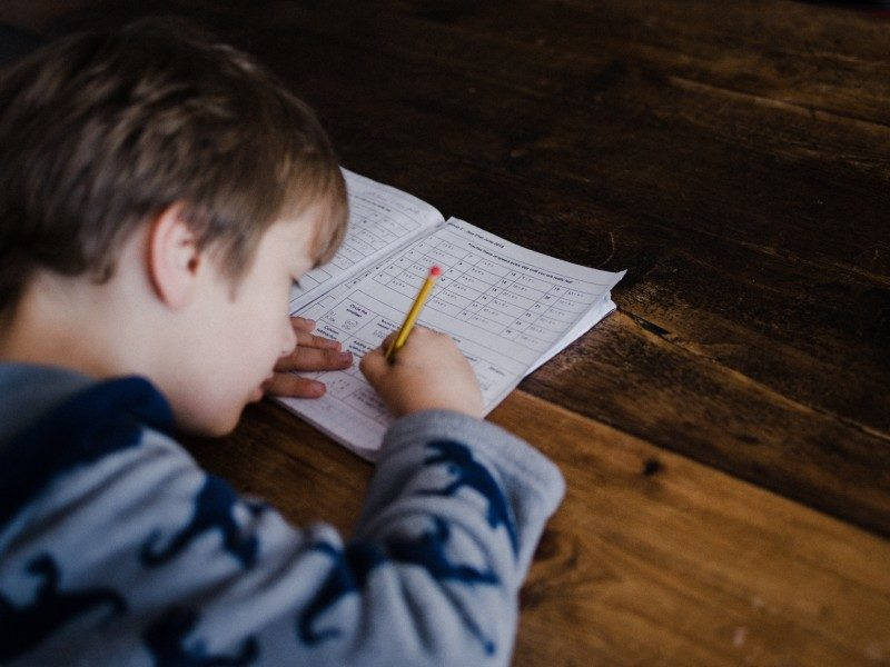 A boy doing homework at a desk
