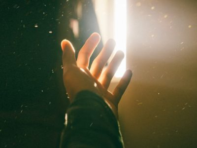 A hand reaching into the light