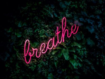 The word 'Breathe' set against a dark background