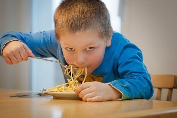 a child eating spaghetti
