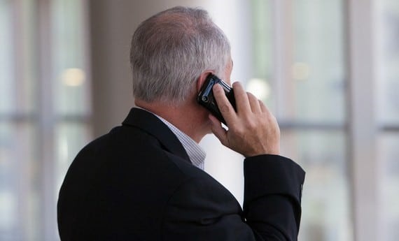 a man holding a mobile phone to his ear