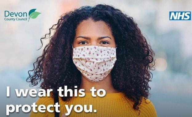 a woman wearing a face mask. The wording says: I wear this to protect you.