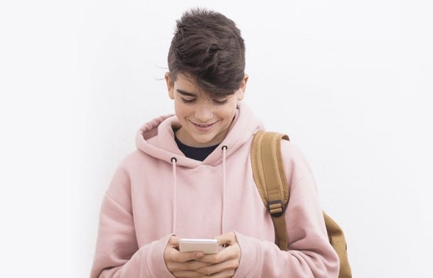 a young person using a mobile phone