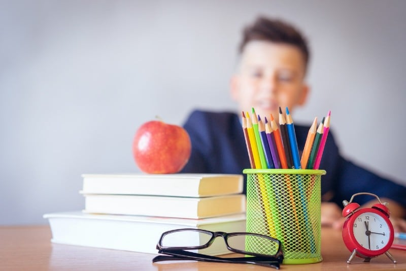 a boy looking at a tidy desk