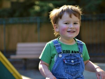 an autistic boy smiling