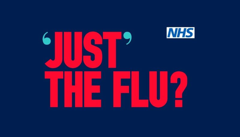 a poster encouraging people to get the flu jab