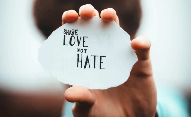a sign saying share love not hate