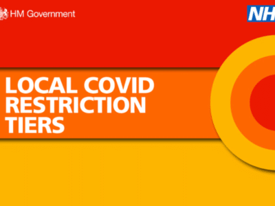 a poster announcing the new COVID tiers