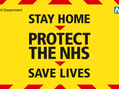 A poster stating stay home, protect the NHS, save lives