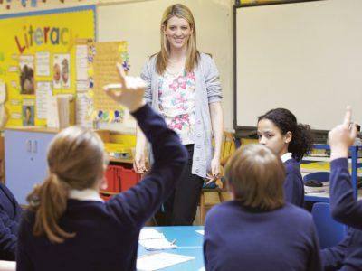 a teacher and her class of children