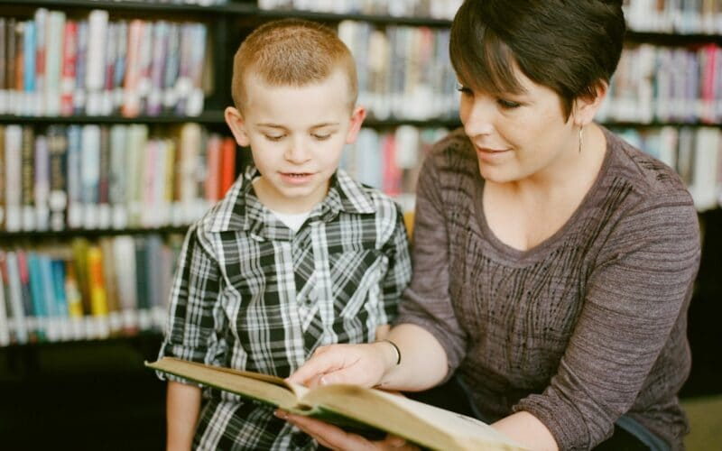 Adult and child reading a book