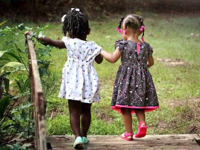 two children walking across a bridge