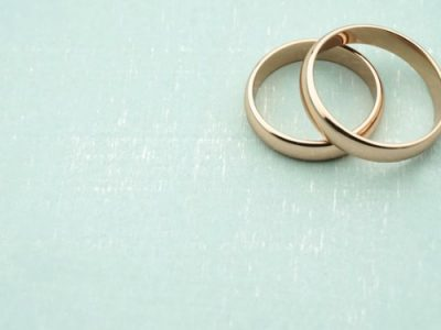 two gold wedding rings overlapping
