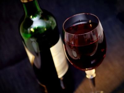 Picture of a bottle and glass of red wine