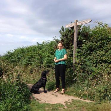 lady with dog on a footpath