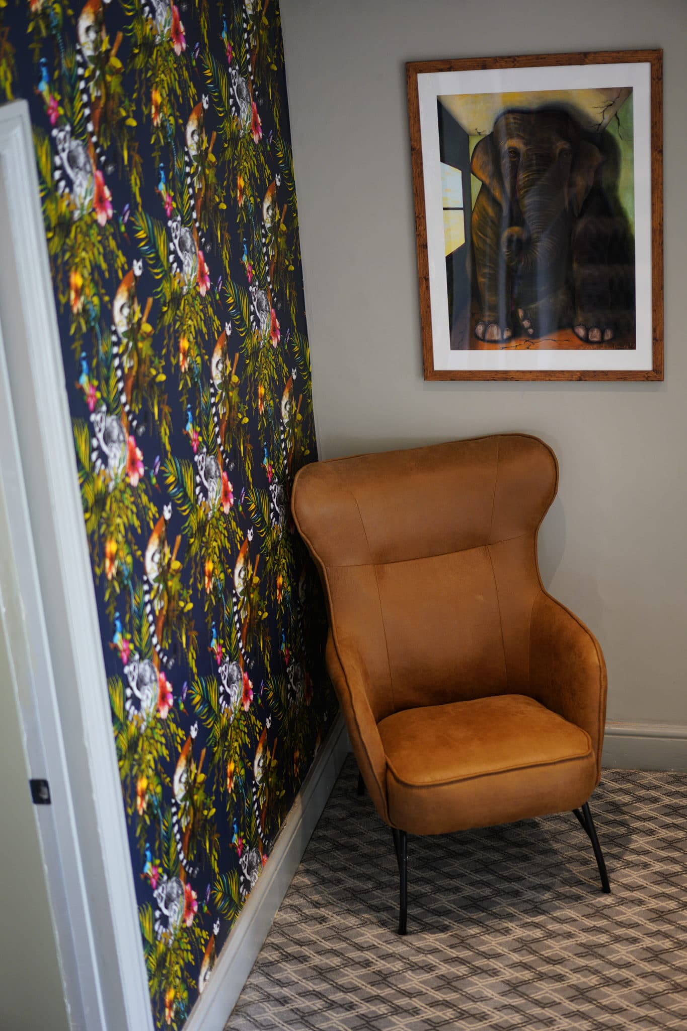 Waiting area with a chair at The Nook, Honiton