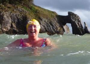 Lady wild swimming in the sea